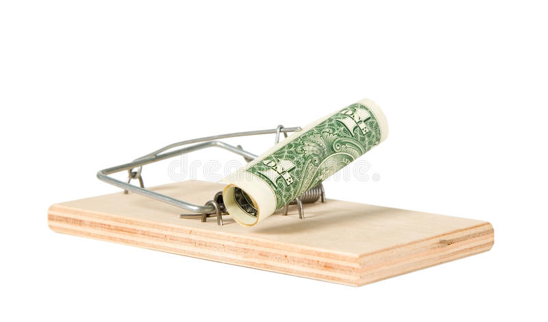 A mouse trap with money. On it stock images