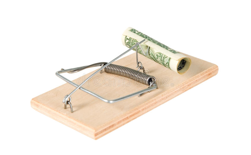 A mouse trap with money. On it stock image