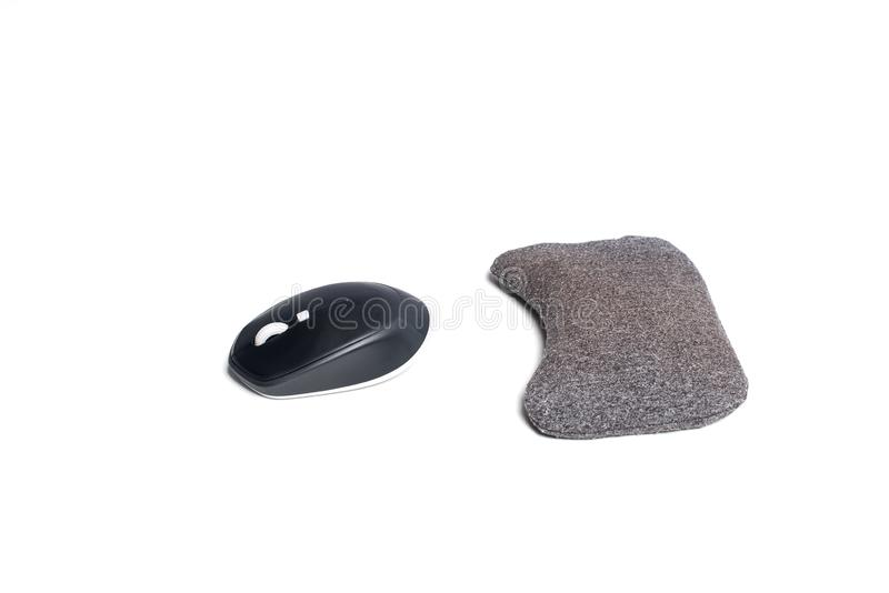 Mouse and wrist protector. Black computer mouse with wrist rest. Isolated on white royalty free stock image