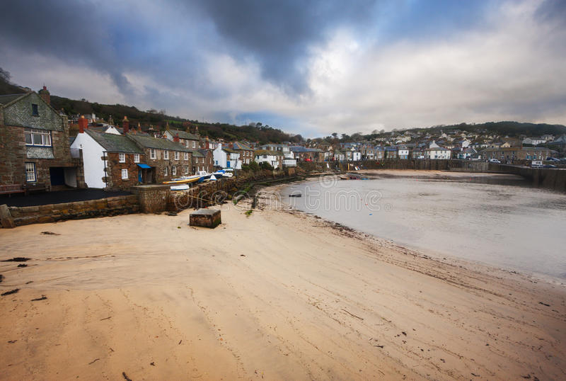Mousehole village Cornwall - England. Mousehole fishing village in Cornwall, England on a cloudy day royalty free stock photo