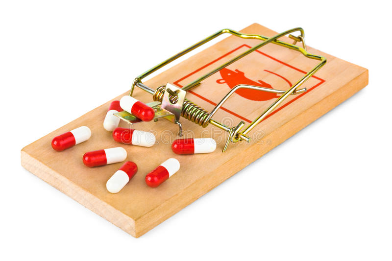 Mousetrap and pills stock photography