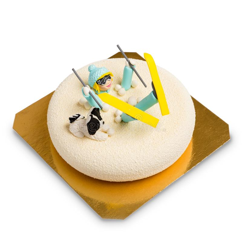 Mousse cake decorated fondant figure of a fallen skier woman royalty free stock image