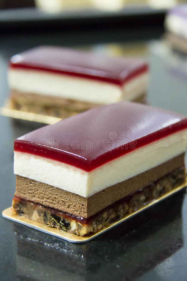 Mousse layer cheese cake on a table. A mousse layer cheese cake on a table stock photography