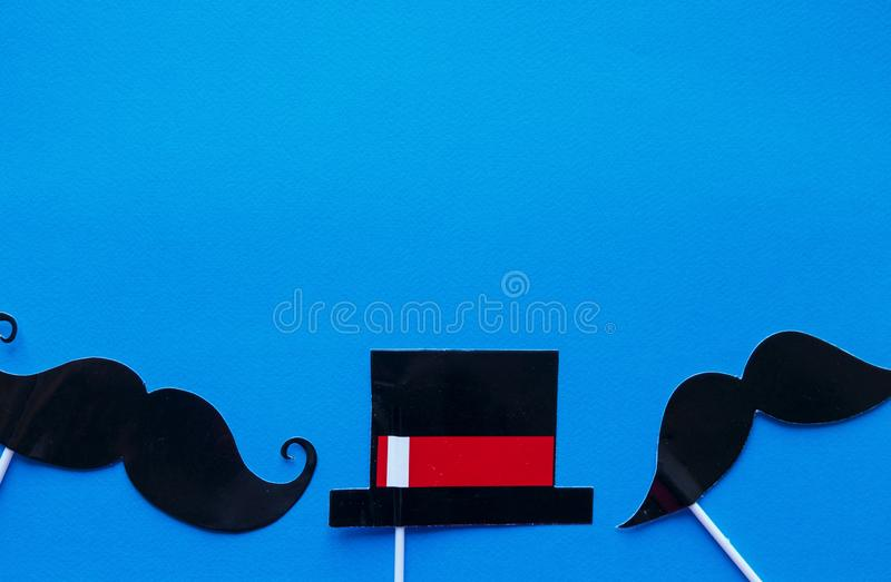 Moustache photo booth props on blue background. Moustache cut outs. Prostate Cancer Awareness, Men health awareness concept. stock photography