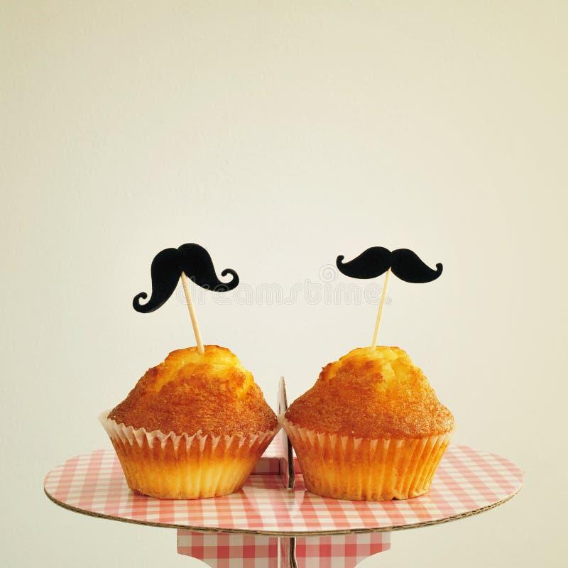 Moustaches en petits gâteaux, avec un rétro effet image stock
