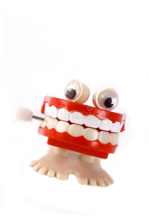 Mouth full of teeth windup toy royalty free stock photo