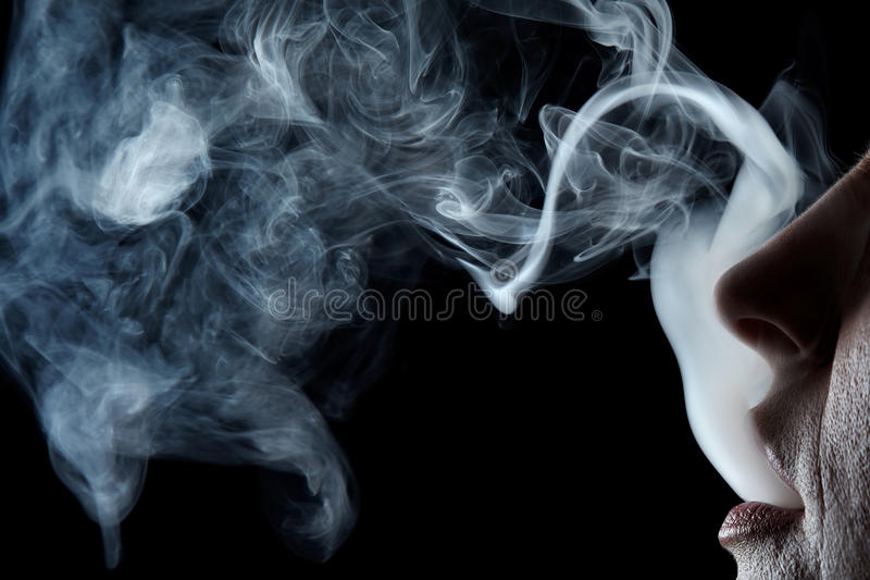 Mouth with smoke royalty free stock image