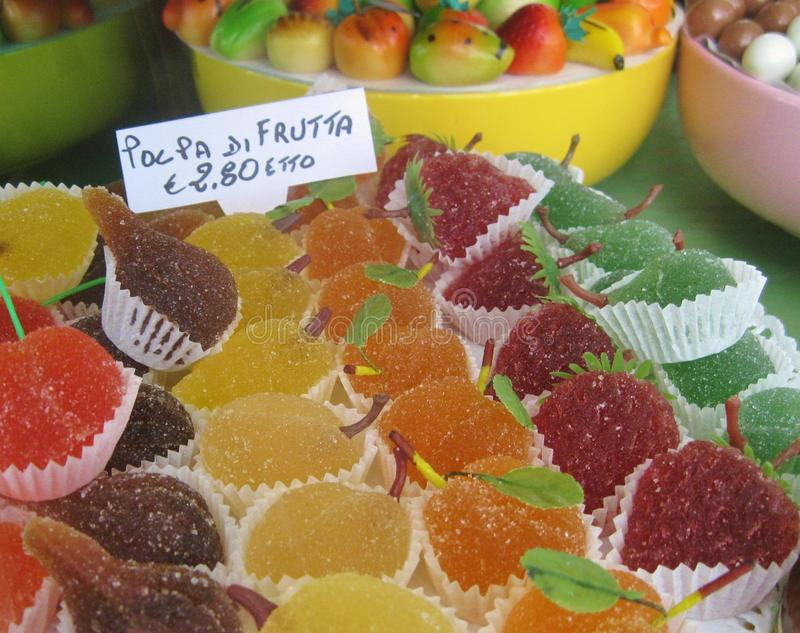 Mouthwatering Italian shop window display of colorful fruit jelly candies, marzipan and other sweets stock photos