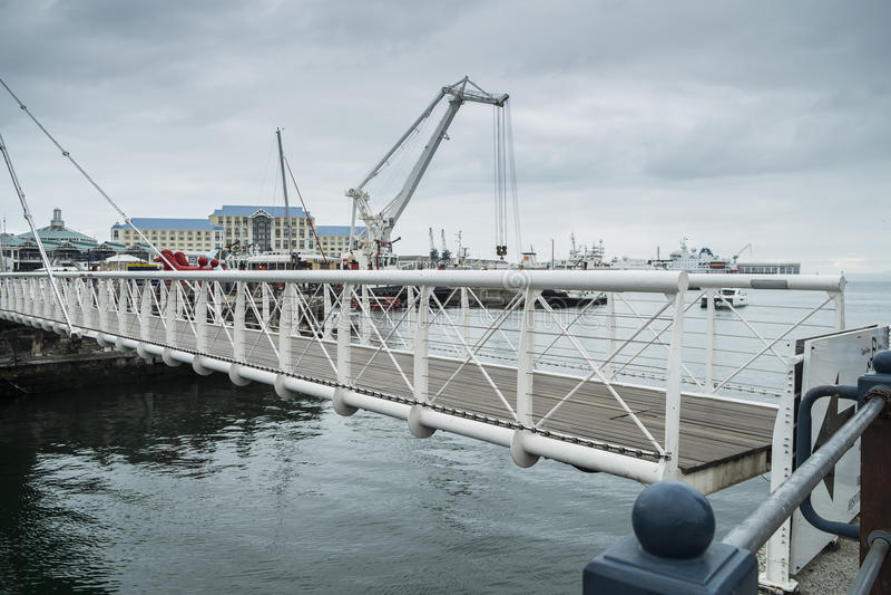 Movable bridge at waterfront harbor royalty free stock image