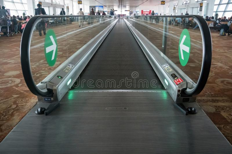 Movable conveyor belts at the airport, straight flat escalator stock photography
