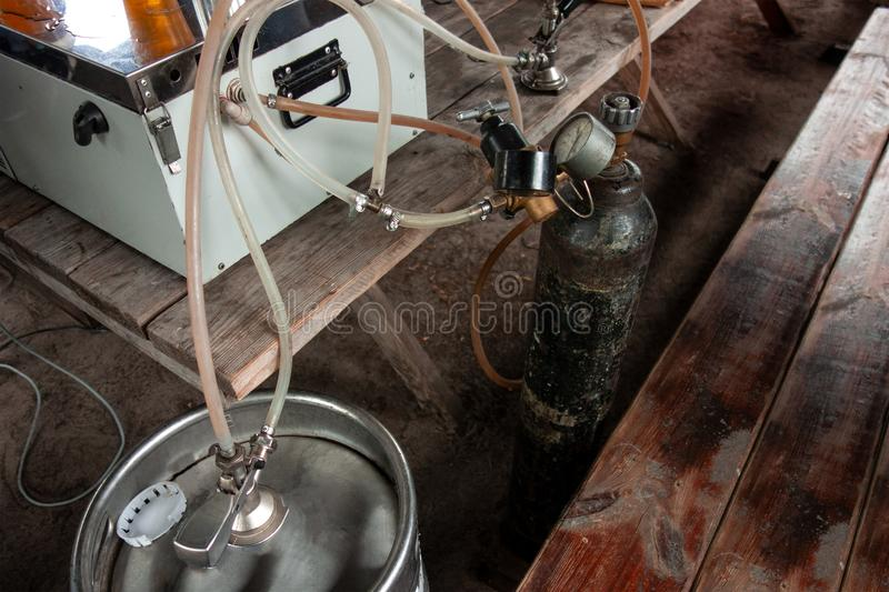 Movable draft beer pouring equipment for outdoor party or picnic. Close up image of manometers, valves, pressure vessel, pipes,. Keg and cooler system. Rustic royalty free stock image