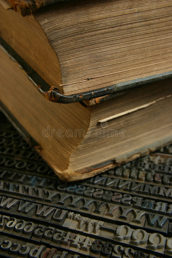 Movable type with old book stock photography