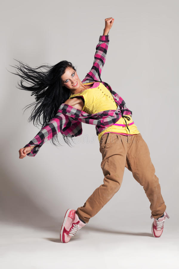 In the move. Young girl performing hip-hop dance stock photo