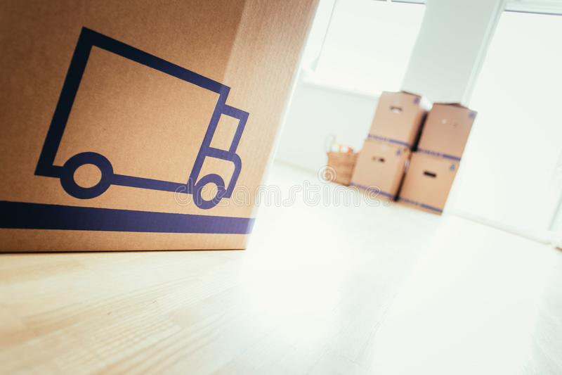 Move. Cardboard, boxes for moving into a new, clean and bright home. Move. Cardboard, boxes and stuff for moving into a new home house bright house-building stock image