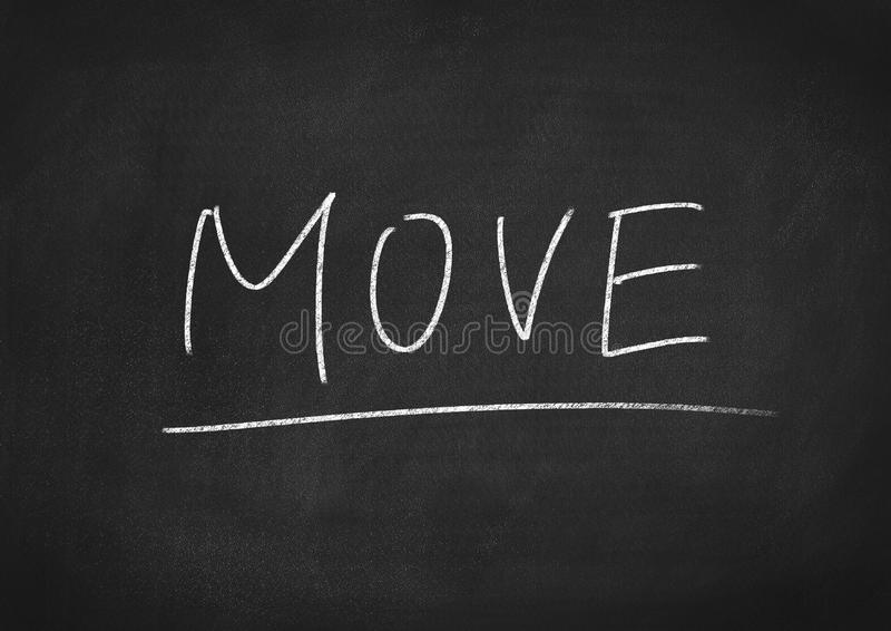 Move. Concept word on a blackboard background royalty free stock photos