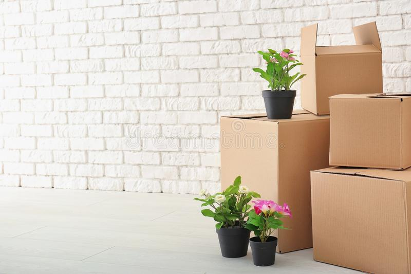 Move house concept. Carton boxes and belongings. On floor in empty room stock photos
