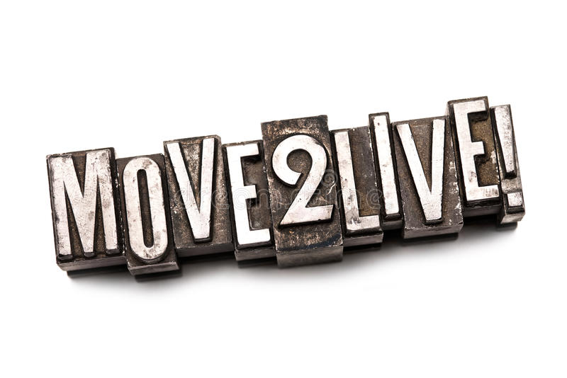 Move 2 Live!. The phrase Move 2 Live! in letterpress type. Cross processed, narrow focus stock image