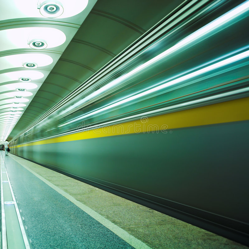 Move train in green. On platform in subway stock photography