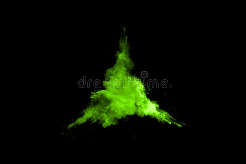 The movement of abstract dust explosion frozen green on black background. stock photos