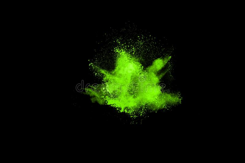 The movement of abstract dust explosion frozen green on black background. royalty free stock photos