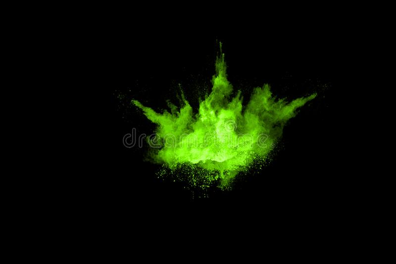 The movement of abstract dust explosion frozen green on black background. royalty free stock image