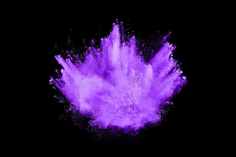 Purple powder explosion on black background. Freeze motion. royalty free stock photography