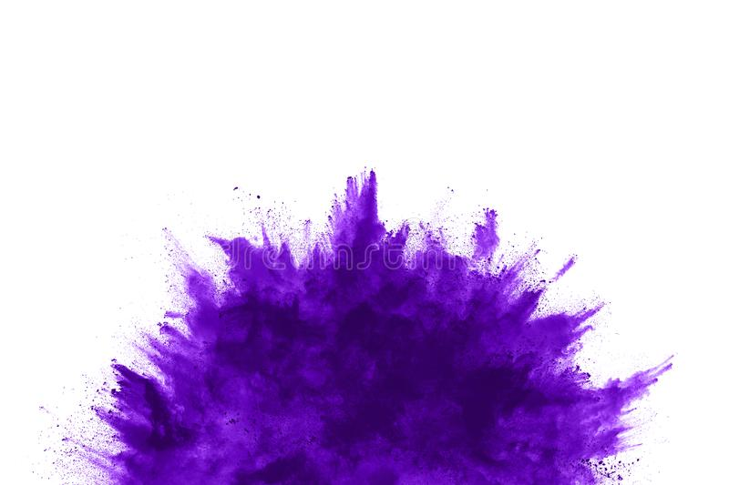 The movement of abstract dust explosion frozen purple on white background. stock photo