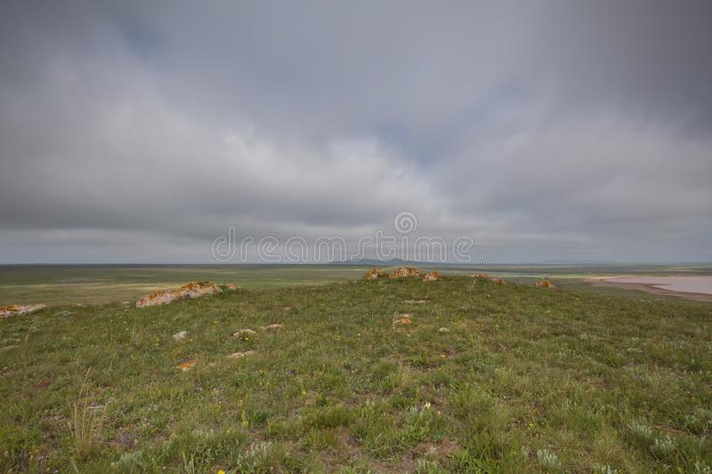 The movement of clouds in the spring in the steppe part of the C. Russia. The movement of clouds in the spring in the steppe part of the Crimea peninsula at Cape stock photography