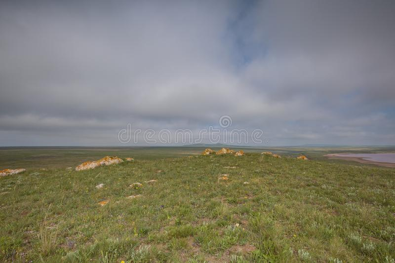 The movement of clouds in the spring in the steppe part of the C. Russia. The movement of clouds in the spring in the steppe part of the Crimea peninsula at Cape royalty free stock images