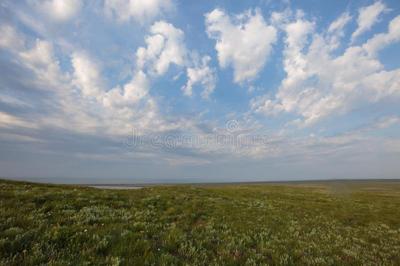 The movement of clouds in the spring in the steppe part of the C. Russia. The movement of clouds in the spring in the steppe part of the Crimea peninsula at Cape stock image