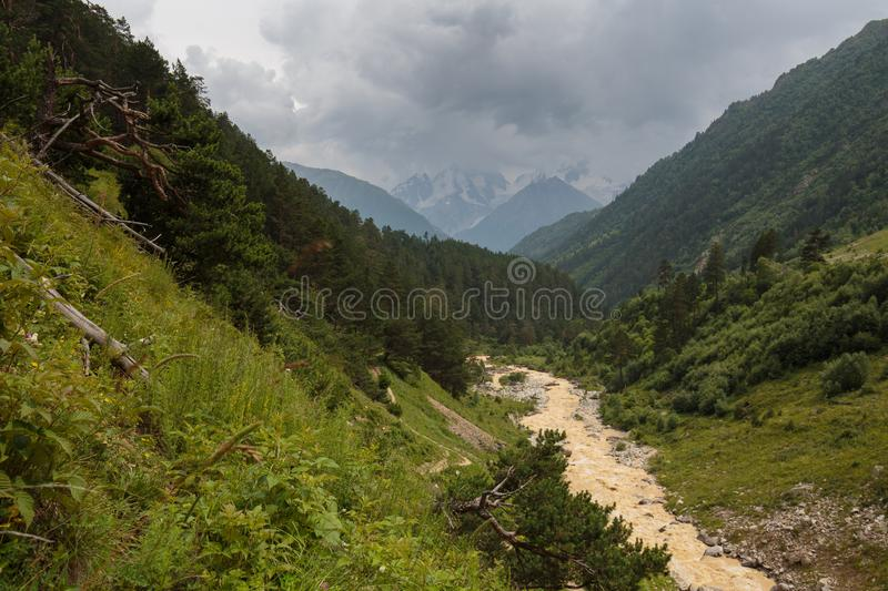 Movement of clouds and water flows in a stormy river in the Caucasus mountains in summer. Russia. Movement of clouds and water flows in a stormy river in the royalty free stock photos