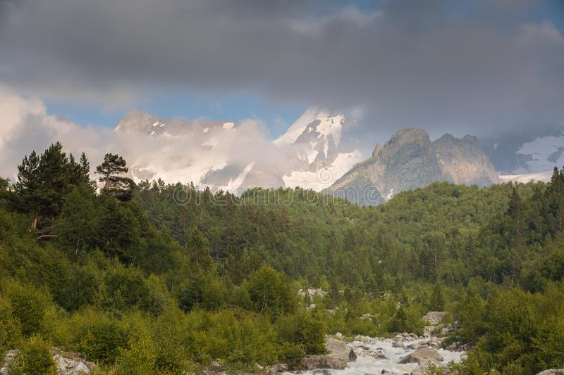 Movement of clouds and water flows in a stormy river in the Caucasus mountains in summer. Russia. Movement of clouds and water flows in a stormy river in the royalty free stock images