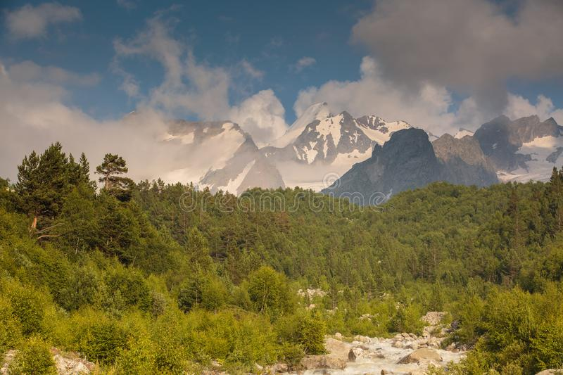 Movement of clouds and water flows in a stormy river in the Caucasus mountains in summer. Russia. Movement of clouds and water flows in a stormy river in the royalty free stock image