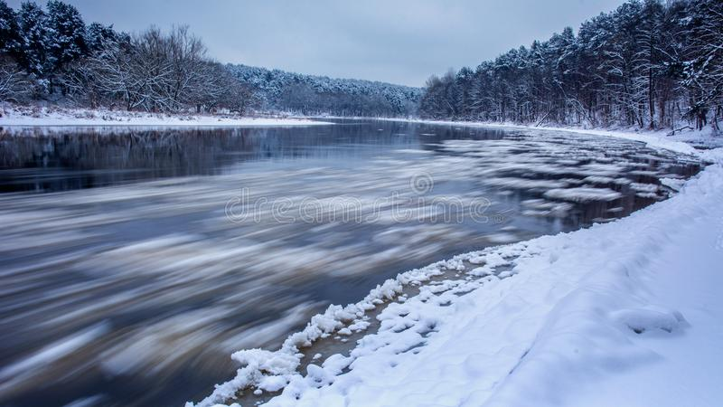 Movement of forming ice floes in river Neris during winter in Vilnius stock image