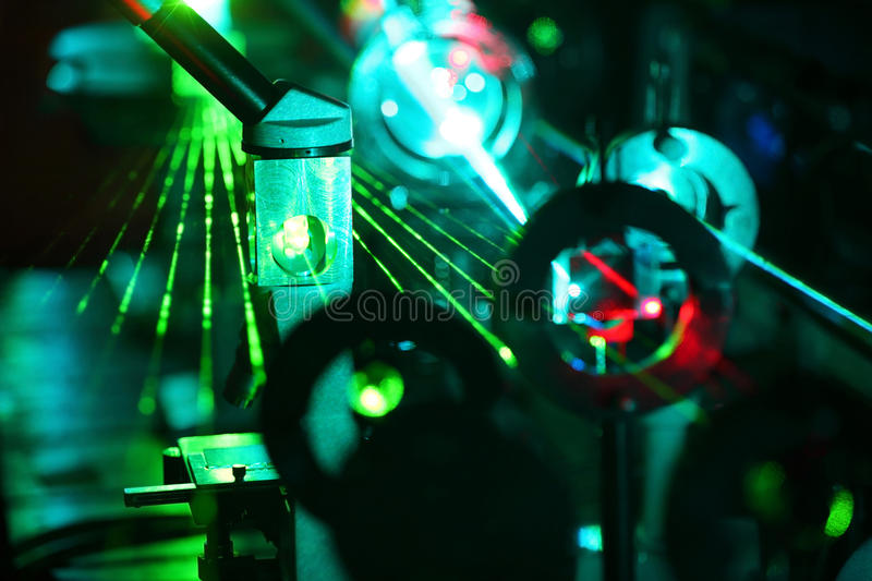 Movement of microparticles by beams of laser stock images