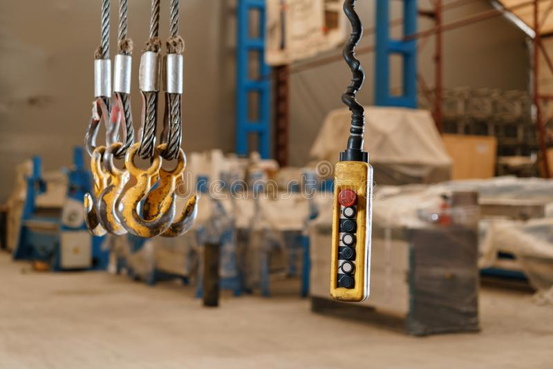 Movement remote control pendant switch for overhead crane in the factory royalty free stock images