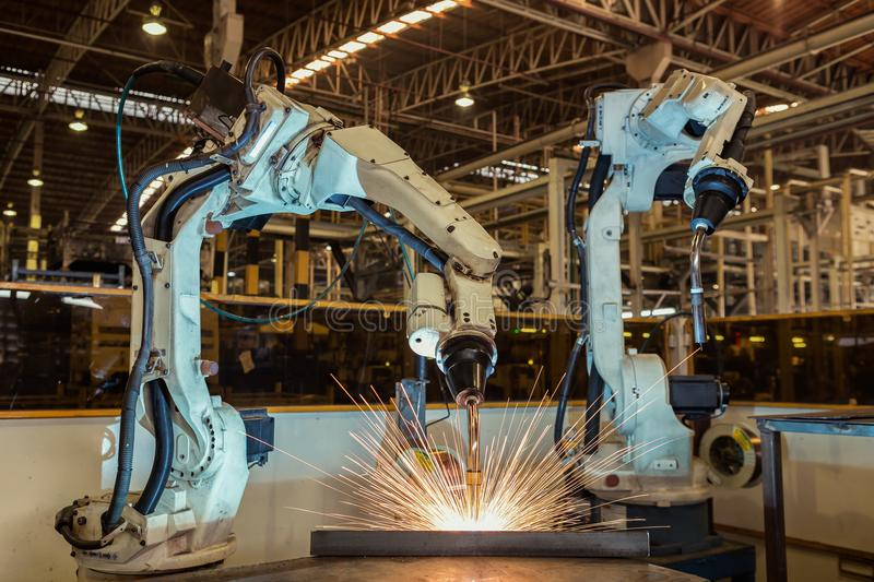 Movement of robot welding in factory royalty free stock photo