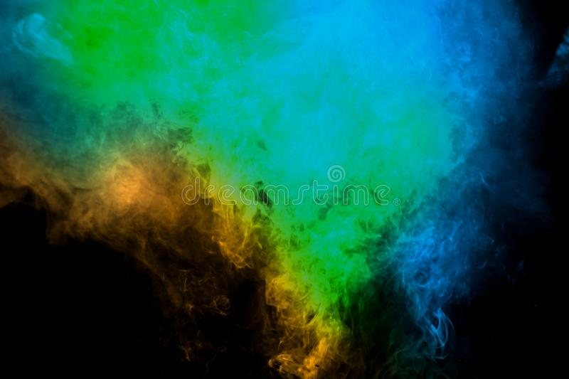 Movement of smoke. Abstract green blue color smoke on black background. Abstract Smoke Clouds stock photo