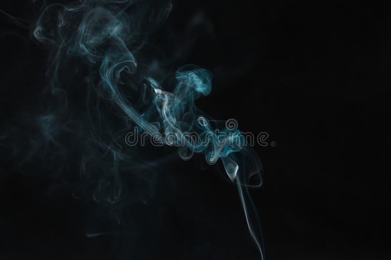 Movement of smoke on black background, design concept royalty free stock images