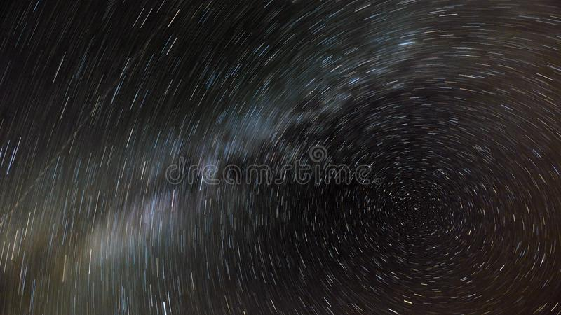 The movement of the stars and the milky way in the night sky around the North star. Night photography royalty free stock photos