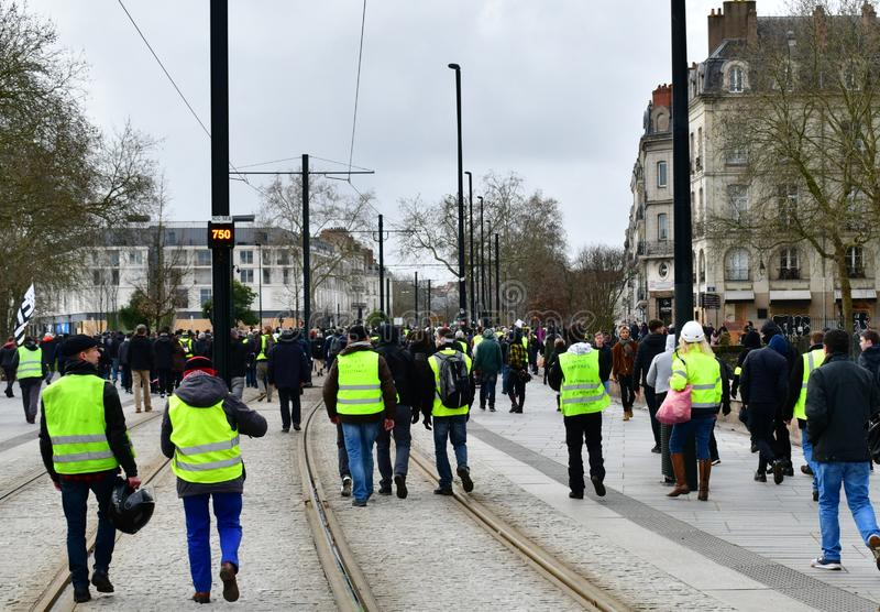 France, Nantes - February 9, 2019: Protest action of the `yellow vests` on the Allée du Port Maillard. The movement of `yellow vests` is rapidly gaining royalty free stock photo
