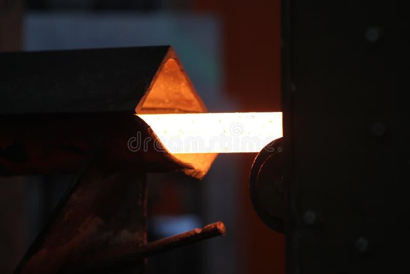 Movendo a haste de metal caloroso fotos de stock
