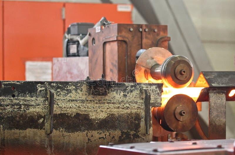 Movendo a haste de metal caloroso foto de stock