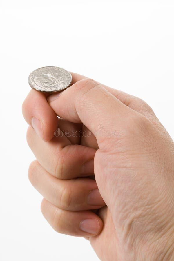 Mover de un tirón la moneda fotos de archivo