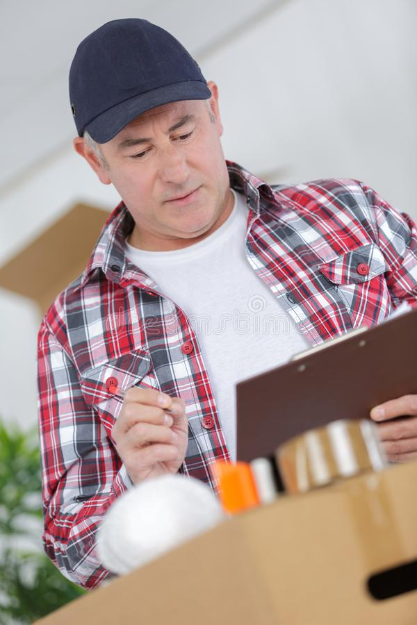 Mover guy holding clipboard pen stock photo