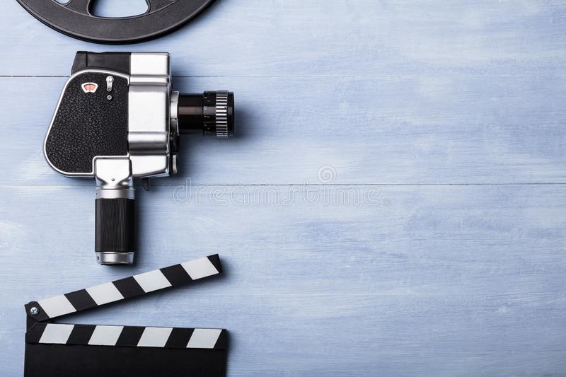 Movie Camera With Film Reel And Clapper Board stock photos