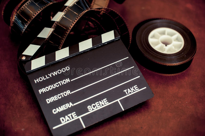 Movie clapper board and filmstrip selective focus. And vintage color effect royalty free stock image