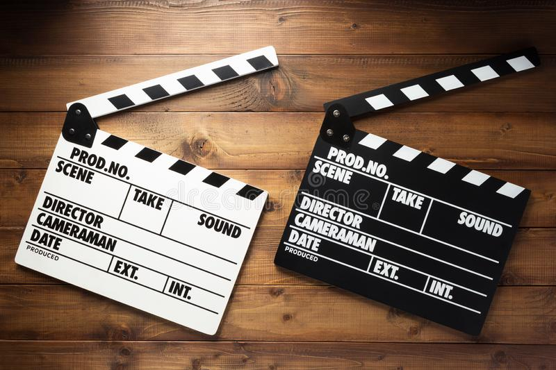Movie clapper board at wooden background stock images