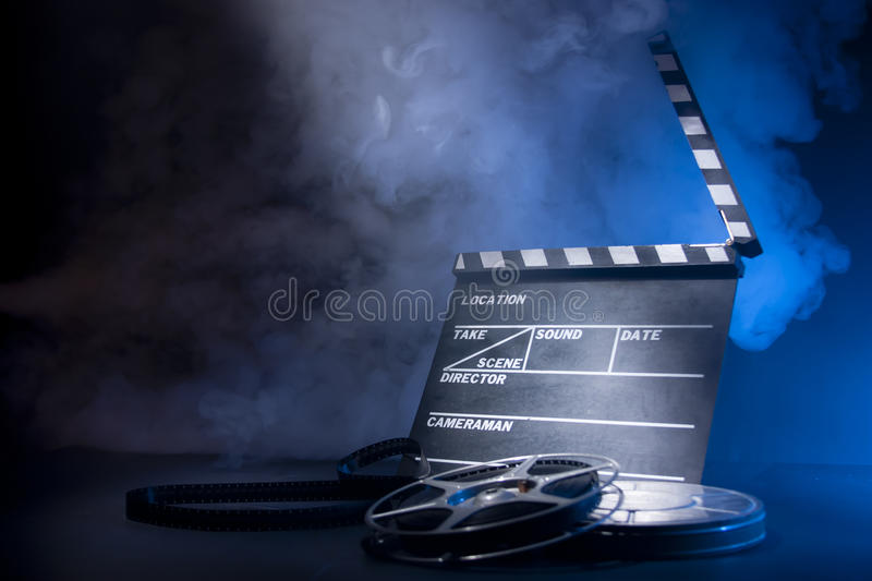 Movie clapper and film reels royalty free stock photography