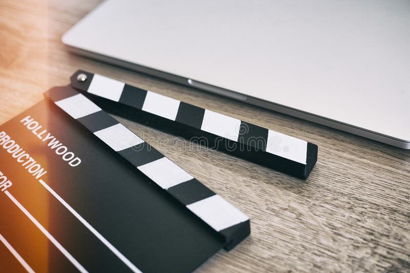 Movie clapper and laptop on the wood royalty free stock photos